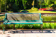 A Bench in the Park with blurry background Stock Images