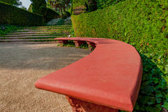Bench in the park with bright greenery. Bench in the mediterranian park with bright greenery Royalty Free Stock Photos