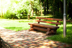 Bench in the park. On a bright sunny day Stock Photography