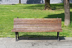 Bench in Park. Classic wooden garden bench in city park Royalty Free Stock Images