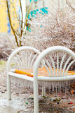 Bench in a park covered with ice Royalty Free Stock Photo
