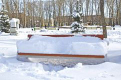 Bench in the park, covered with snow. Russia. Siberia. Winter stock image