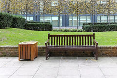 Bench in park. Empty wooden bench in city park Royalty Free Stock Photography