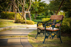 Bench in Park in Evening Royalty Free Stock Photo