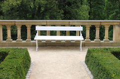 Bench in a park garden Royalty Free Stock Image