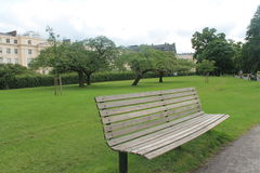 A bench in the park on a green grass background Royalty Free Stock Photos