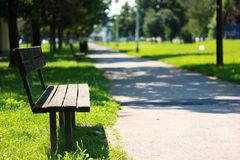 Bench in park. Lonely bench in park. Near footpath in settlement Precko in City of Zagreb Stock Image