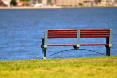 Bench in park near water Royalty Free Stock Images