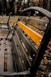 Bench. A bench in  a park on october rain Royalty Free Stock Photos