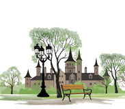 Bench in park with old castle behind Royalty Free Stock Images