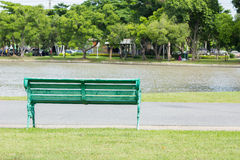 Bench in park by a pond in the background, thailand Royalty Free Stock Images
