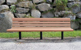 Bench. A park bench in a public place Stock Image