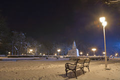 Bench in the park with snow Stock Image