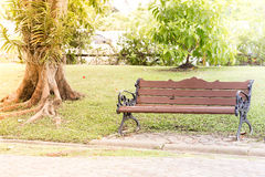 A bench in the park on a sunny day Royalty Free Stock Photo