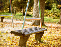 The bench in the park and swing Stock Photos