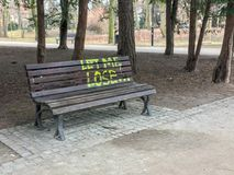 The bench in the park with text `Let me lose`. angle view. stock photography