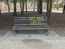 The bench in the park with text `Let me lose`. front view. Poland royalty free stock image
