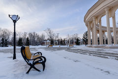 Bench in the park. Bench in theBench in the winter park next to the monumental columns park Stock Image