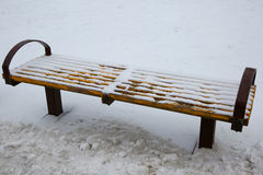 Bench in the park under the snow Stock Photos