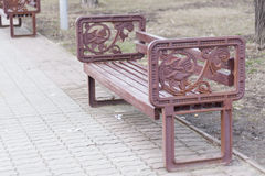 Bench in the park with vintage armrest Royalty Free Stock Photo