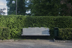 Bench in the park. White wooden metal bench in the town  park Royalty Free Stock Images