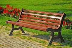 Bench at a park. Wooden park bench at a park Royalty Free Stock Images