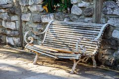 Bench with peeling white paint royalty free stock image