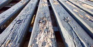 Bench Perspective. Perspective of weathered light blue park bench wooden planks with chipping paint and vanishing point Royalty Free Stock Images