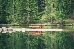Picture of a bench at the Pianozes Lake, Cortina D`Ampezzo, Dolo. Bench at the Pianozes Lake, Cortina D`Ampezzo, Dolomites, Italy Royalty Free Stock Photo