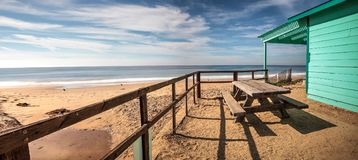 Bench and picnic table at Crystal Cove State Park beach Stock Images