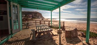 Bench and picnic table at Crystal Cove State Park beach Royalty Free Stock Photo
