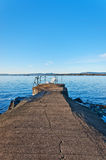 Bench on pier. On a waters of Norwegian Sea Royalty Free Stock Photography