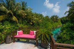 Bench with pillows at Maldives Stock Image