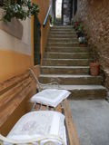 BENCH WITH PILLOWS AND STAIRS IN A STREET IN ROVINJ, CROATIA Royalty Free Stock Photos