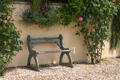 Bench with pink rose Royalty Free Stock Photo