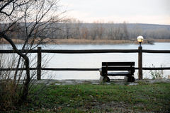 The bench are place for solitude over the river. The bench and lanterns are a beautiful place for solitude over the river at sunset stock photos