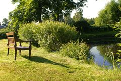 Bench by a pond Stock Photography
