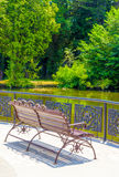 Bench by the pond Stock Photography
