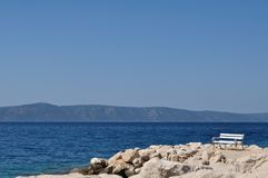 White bench in port. Podgora, Croatia Stock Photography