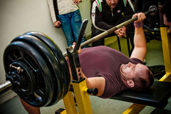 Bench press. PECS - JANUARY 29: Unknown man participates in Amateur bench press championship in Professors GYM January 29, 2011 in Pecs, Hungary Royalty Free Stock Photo