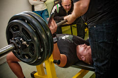 Bench press. PECS - JANUARY 29: Unknown man participates in Amateur bench press championship in Professors GYM January 29, 2011 in Pecs, Hungary Royalty Free Stock Images