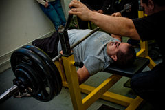 Bench press. PECS - JANUARY 29: Unknown man participates in Amateur bench press championship in Professors GYM January 29, 2011 in Pecs, Hungary Royalty Free Stock Photography