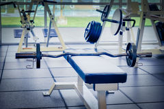 Bench press. Bar, weights and bench as seen in a gym Royalty Free Stock Image