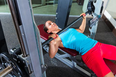 Bench press girl flat multipower Smith machine Stock Photo