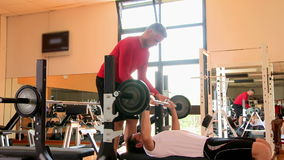 Bench press at gym stock video footage