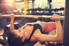 Bench press workout. Woman training on bench press Stock Images