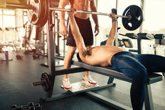 Bench pressing in a gym. Muscular bodybuilder bench press workout Royalty Free Stock Photo