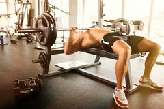 Bench pressing in a gym. Muscular bodybuilder bench press workout Stock Photography