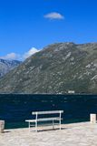 Bench on the promenade in the Bay of Kotor, Montenegro Stock Photos