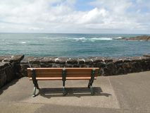 Bench and promenade with stone wall Stock Images